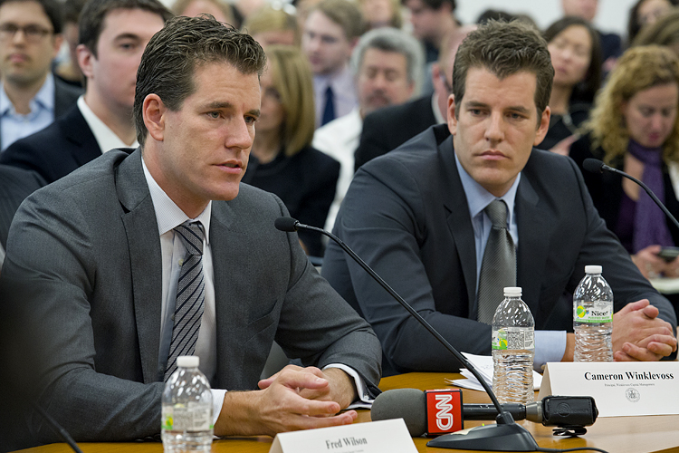 "Brothers Cameron, left, and Tyler Winklevoss, Principals of Winklevoss Capital Management, attend a hearing called ""The Investor Perspective: The Future of Virtual Currencies"" in New York Tuesday, Jan. 28, 2014. The hearing was held by the New York Department of Financial Services to shed light on new currencies and their impact on the modern financial system. (AP Photo/Craig Ruttle)"